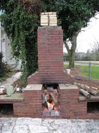 red brick outdoor fireplace without design