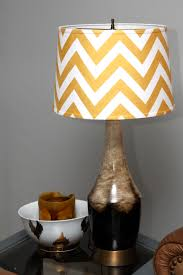 unique yellow gold and white chevron pattern lampshade with beige and brown leather ceramic lamp stand