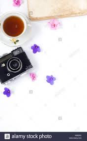 the vine film camera old book flower and tea on white background