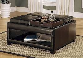 Brown ottoman coffee table features four flip-top cushions with individual  trays, plus lower .