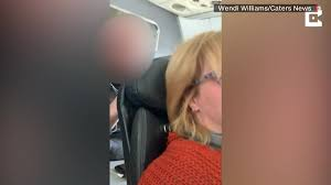 American Airlines passenger said she's injured after her reclined seat was  repeatedly 'punched.' She asked for help, but said a flight attendant  threatened her - CNN