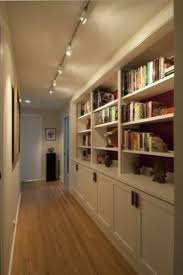 interior track lighting. Provocative Hallway Interior Design Idea With Bookshelf Also Pendant Metal Track Lighting Fixtures