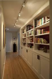 provocative hallway interior design idea with bookshelf also pendant metal track lighting fixtures