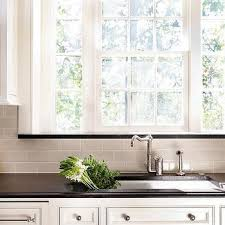 kitchen window sill.  Window Ivory Kitchen Cabinets With Black Granite Counters And Gray Subway Tiles In Window Sill I