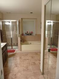 existing bathroom features pink glazed ceramic tile for the shower surround as well as the