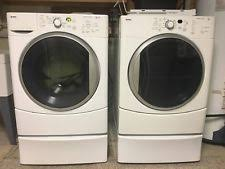 kenmore front load washer and dryer. kenmore he electric washer and gas dryer set used. has drying rack. front load