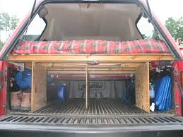 the author s truck note the pivoting lights up top sleeping platform with