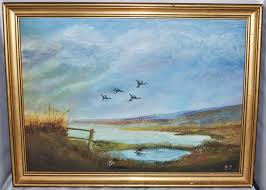 painting on board of ducks flying over the countryside signed initials e y