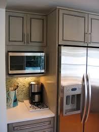 microwave shelf beside the fridge