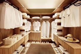 walk in closet wardrobe in light wood tones