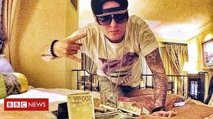 Plinofficial: Russian <b>rapper</b> who loved dollars arrested by FBI - BBC ...