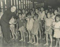 Image result for Father Edward J. Flanagan, opens the doors to a home for troubled and neglected children near Omaha,