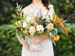 Dusty blue pink gold classic wedding ideas Dusty Rose Fall Wedding Centerpiece With Greenery And Yellow Amaranthus Elegant Wedding Invites 14 Fall Wedding Colors Palettes That Feel Totally Modern Weddingwire