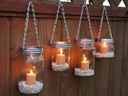 diy mason jar hanging lights mason jar lighting hanging on a fence diy hanging mason jar