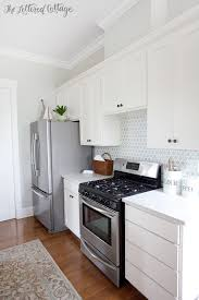 The Lettered Cottage Kitchen Cabinets are Simply White Walls are Gray Owl lightened by 50 percent Backsplash from Caledonia Stone and Tile