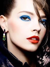 cobalt blue eye makeup orange red lipstick red lips makeup blue makeup and eye makeup