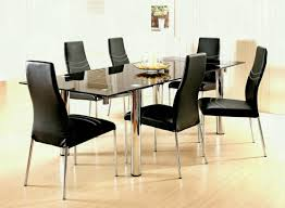 leather dining chairs modern. Black Modern Leather Dining Chairs With Glass Table Big White Candles And Jar Centerpiece Decoratioin Room