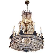 french bronze and crystal three tiered chandelier circa 1820