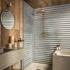wall cladding in the bathroom will add an industrial look to the place without taking off its elegant touch however a special coating should be applied to