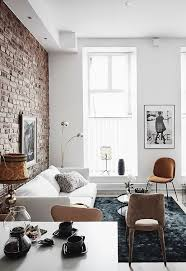 exposed brick and black bedroom walls
