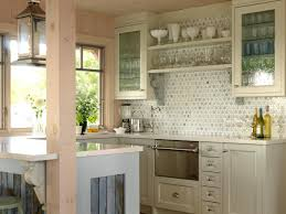 Love this kitchen! The herringbone white backsplash tile with marble  countertops and glass faced cabinetry