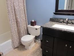 bathroom vanities black frame rectangular mirror on white wall mosaic ceramic tiles bathtub deck free