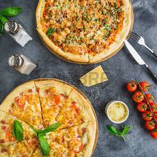 delicious food background. Contemporary Food Delicious Pizza With Bacon Cheese Tomato On Dark Background Flat Lay Top On Food Background Z