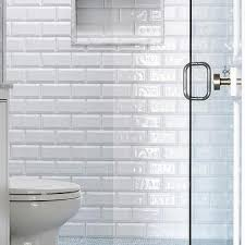 white beveled shower tiles with blue grid shower floor tiles