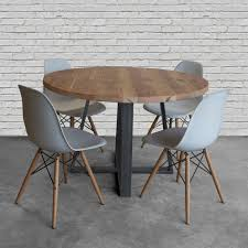 small round oak dining table round top pedestal table in reclaimed wood and steel legs in