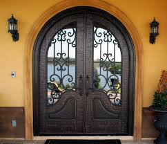 strong fibergl arched entry door design with curved sidelights wrought iron