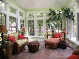 inside sunrooms interior decorating with sofa and plants with green