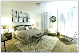 10 photos gallery of area rug under bed with hardwood floors