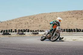 learning the art of sliding at supermoto school cycle world