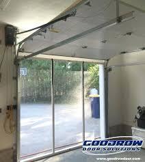 sliding garage door screen this inside view of a retractable garage door screen by sliding garage