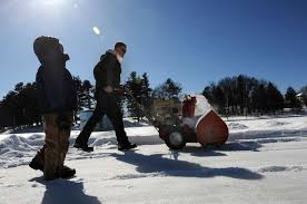 garth osier of schenectady clears snow on iroquois lake in central park with his son dominick