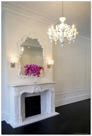 mirror over fireplace. classic white framed mirror over mantled fireplace in beautiful pendant lamp a pair s