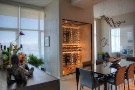 modern wine cellar pendant lamp black dining table black leathered chairs wood vinyl floor wine cellar