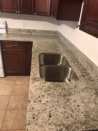 dallas white granite dallas white granite countertop and stainless steel double sink