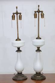 stunning and elegant electrified oil lamps of milk glass and heavy brass
