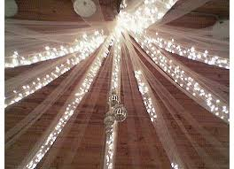 Ceiling draping with fairy lights to transform a venue to a beautiful, airy  and welcome room!!
