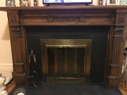 what color type of tile do you think would go best with my dark wood fireplace mantel looking to tile around the fireplace insert as well as the