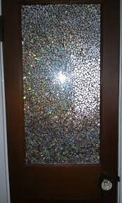16 diy projects using old and scratched cds create a stunning mosaic door