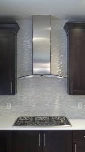 glass range hoods. Stainless Range Hood And Glass Tile Backsplash. Kitchen #interior Design By SKD Studios Skdstudios.com Hoods D