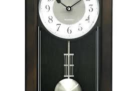 chiming pendulum black wall clock hands white dial a bulova clocks