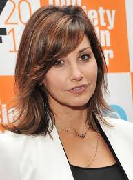 gina gershon um wavy hairstyle with bangs for thick hair