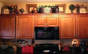 decorations on top of kitchen cabinets. Top Cabinet Decorating Ideas Decorate Kitchen . Decorations On Of Cabinets