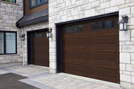 walnut garage doorsResidential garage doors  Steel or wood  Garaga