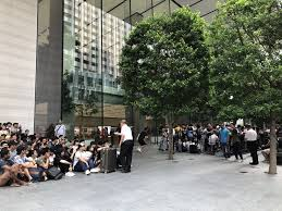 Customers Waiting in Line at Apple Retail Stores Around the World ...