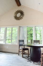 the barrel base on this found dining table adds industrial style to a cote sunroom with