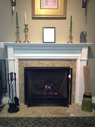 direct vent gas fireplace and wood mantel traditional living room